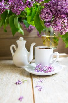 Lilac flowers and coffee by Anna Bogush