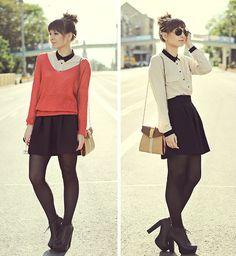 Creme shirt with black collar and buttons, rose colored lightweight sweater, black skirt, black tights and lace up ankle boots