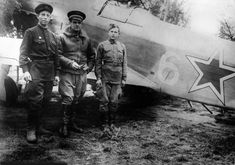 Commander of 1st Squadron, 1st Independent Regiment Fighting France 'Normandy' Marcel Albert (Marcel Olivier Albert, 1917 - 2010) with AMEs AP Averyanov and M. Mamaev from his Yak-9 number 6.