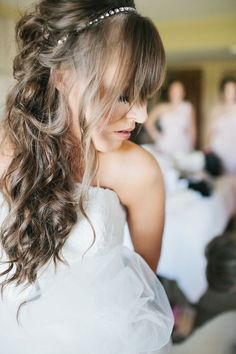 Bold Bangs: Show off some fringe! This look is done perfectly with a crystal headband and full curls. | Photo by Bethany Belle | See more hairstyles for long hair here: http://www.mywedding.com/articles/10-wedding-hairstyles-for-long-hair/
