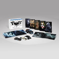 Dark Knight Trilogy 'Ultimate Edition' - SO cool! Includes all movies on blu-ray, special features, art book, five 'villain' art prints and three Hot Wheels vehicles...