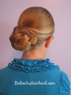 Braided bun under pull-through, not that hard to do but is looks great.