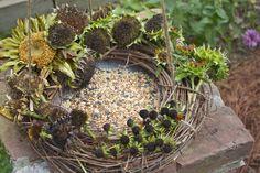 LittleHouseintheSuburbs shows her grapevine wreath bird feeder - use all those fall-pruned flower heads
