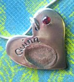 Handmade Silver Fingerprint Jewellery Heart Shaped Pendant with embedded cz garnet birthstone.
