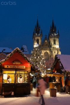 Snow-covered Christmas Market and Tyn Church, Old Town Square, Prague, Czech Republic