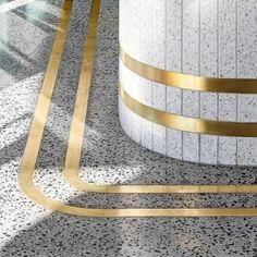 Golden Brass Spacers Between The Terrazzo Tiles