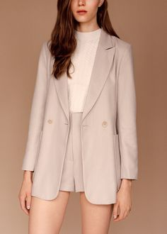 This '70's-inspired longline jacket would look so retro-chic with a pair of woven platform sandals.