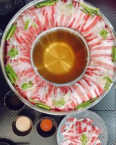 A5 Miyazaki wagyu and Iberico pork shabu-shabu set (S$38.80) from Shabu En by EN Group. Theres one at @parkwayparadesg just across from @monstercurry.sg and another outlet at @downtowngallerysg . This new Kyushu Taki Nabe features a new way to enjoy hotpot: simply push in a mound of meat atop vegetables straight into the boiling hot soup. Its patterned after Sakurajima the volcano island at Kagoshima prefecture. . Comes with choice of three broths: dashi bonito & kombu (shown here) chicken pai Shabu Shabu, Kagoshima, Kyushu, Hot Soup, Miyazaki, Volcano, Japanese Food, Pork, Island
