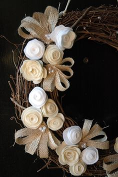 a sweet wreath with felt flowers, burlap, and pearls.