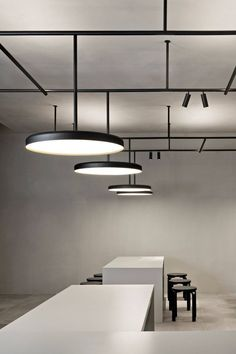 Vincent Van Duysen's Infrastructure lighting system for Flos Architectural on display. Stand x VVD   Minimalissimo