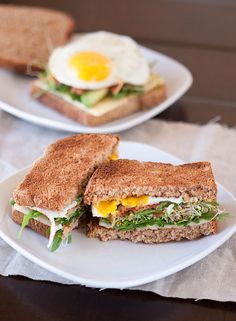 sunny side up egg sandwich with bacon, avocado, greens, cheese.  so good!    // armelle blog