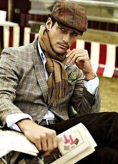 Great layered look for men. Mixed plaids and patterns with cap, green pocket square and scarf. [Brand information not provided by source]