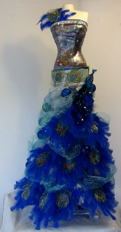 Mannequin Christmas Tree With A Peacock Theme - Seams And Scissors Mannequin Christmas Tree, Dress Form Christmas Tree, Peacock Christmas Tree, Different Christmas Trees, Peacock Ornaments, Beautiful Christmas Trees, Christmas Gift Decorations, Christmas Tree Themes, Old Christmas