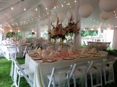 Lighting illuminates an elegant tablescape awaiting guests under a tent on the East Terrace of Salisbury House and Gardens.