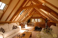 Interior of a studio on top of an oak garage with stunning oak framed ceiling.