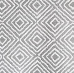 An upholstery diamond patterned fabric in grey. This fabric is very durable and is perfect for heavy weight upholstery, pillows and most any home decor project.