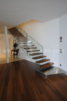modern floating stair with structural glass railing, wood treads and stainless steel landing http://www.sillertreppen.com/en/siller-stairs/