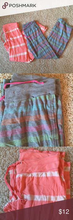 Two pairs of pajama pants Two pairs of xhilaration pajama pants. One is pink and white striped the other is grey with different colored stripes. The pink one has a small stain at the bottom but you can hardly see it, other than that, Both in great condition, they just don't fit me anymore Xhilaration Intimates & Sleepwear Pajamas