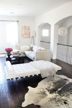 white living room against white base and dark floors #chaise #sectional
