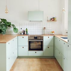 Kittens and IKEA hacks, two things one can never have enough of. Tikkie Elsøe @tikkie_adelie and her husband, Mads', fresh green Copenhagen kitchen by reformcph, who provided the cabinet fronts and oak counters. More on RM today. #rmkitchen Karen Maj Kornum @anotherballroom #ikeahacks #Regram via @remodelista