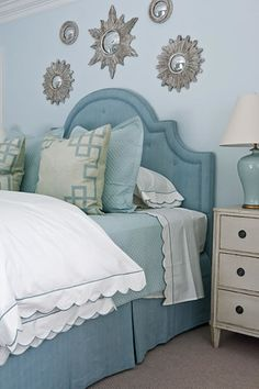 Robbins egg blue headboard with silver starburst mirrors, and Chelsea Textiles side table