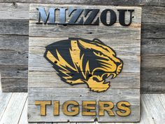 A personal favorite from my Etsy shop https://www.etsy.com/listing/213325669/mizzou-tigers-23-x-23-approx-item-0312