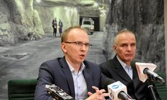 KGHM chief executive Radosław Domagalski-Łabędzki and vice-president Piotr Walczak hold a news conference after Rudna mine disaster.