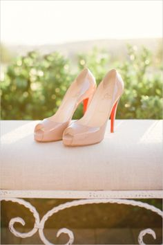 blush pink Louboutins #weddingshoes #bride #weddingchicks http://www.weddingchicks.com/2014/02/07/pink-and-black-wedding/