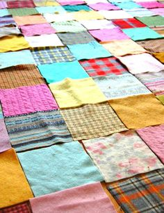 A quilt made of miscelaneous wool squares.