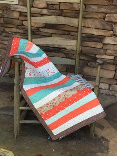 This beautiful quilt is 33x44. Made with cream, brown, teal, white, and pink tones. Great for a new baby girl! 100% cotton. Top is regular cotton, and back in white cotton flannel to give a super soft