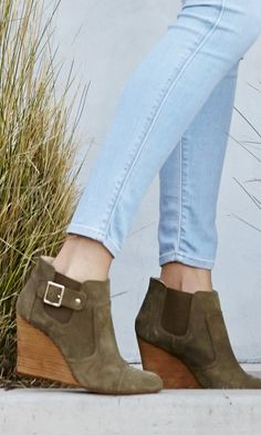 Suede wedge bootie with buckle detailing, stacked leather heel and elastic sides.