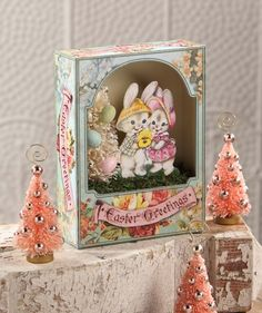 Easter Greetings Shadowbox from The Holiday Barn. I have the free printable image of two rabbits or bunnies holding a pansy