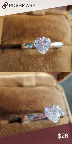 Vintage Sterling Silver Heart Cz Stone Ring Vintage Sterling Silver Heart Cz Stone Ring. Size 9 Marked 925 tested. Beautiful prong set stone. Looks Just like a big fabulous diamond. Great Condition. Jewelry Rings