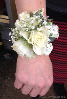 Don't spoil your wedding outfit with a pin - get one of these Ivory Rose and Gypsophila Wrist Corsages for the ladies in the bridal party | Bridal Florist (Booker Flowers and Gifts) Booker Weddings are Wedding Flower specialists and have been specially selected to be one of Interflora's Vera Wang Wedding Florists.