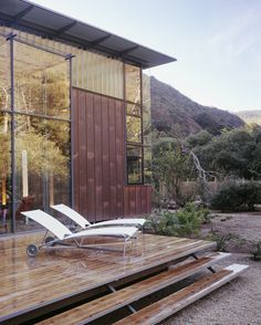 Steep canyon walls dominate this wooded site next to a creek in California's Big Sur region. When the owners first commissioned us, local governing agencies ...