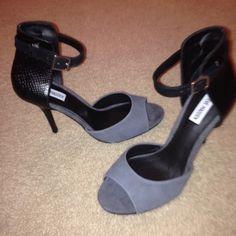 Steven madden heels Grey sueded front with snake skin back.  Never worn Steve Madden Shoes Heels