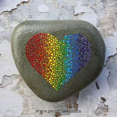 A Heart shape painted in rainbow dots on a heart shaped sea stone. 14 x 13cm 1015g The stones are varnished before and after painting but it is not advisable to keep them in a permanently damp or wet place.