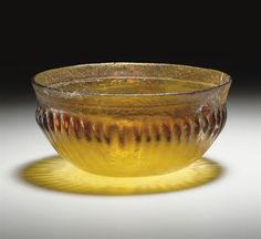 A ROMAN RIBBED GLASS BOWL CIRCA LATE 1ST CENTURY B.C.- EARLY 1ST CENTURY A.D.