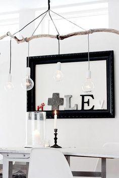Combineer kabel hanglampen met een mooie tak uit de natuur en maak je eigen lamp boven de eettafel!
