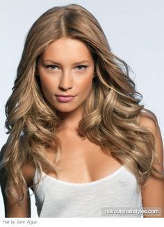 Long, loose, dirty blonde curls - her skin is a little too dark for this color, but over all, I like the look.