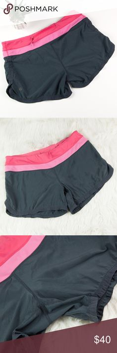 "Lululemon Gray Pink Groovy Run Shorts Wet Dry Warm Who doesn't love Lululemon? Lululemon Gray & Pink Groovy Run Shorts. Built in underwear, back waistband zip pocket, hidden waistband looped drawstring. Lululemon symbol and interior ""wet.dry.warm."" lettering are faded, otherwise excellent pre-loved condition!   All measurements taken laying flat Waist measures approx. 15.5"" Front rise approx. 8.5"" Inseam approx. 4.5""  🚫no trades 🚫no modeling ✅dog friendly/🚭smoke free home ✅reasonable…"
