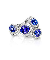 Tanzanite is blue-purple. Mastercrafted in white gold Ava rings are set with large oval shaped tanzanites and diamonds. Diamond Jewelry, Jewelry Rings, Jewelery, Fine Jewelry, Tanzanite Engagement Ring, Tanzanite Rings, Engagement Rings, Dress Rings, Jenna Clifford