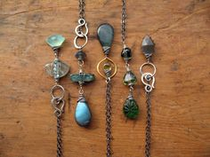 Wire Wrapped Gemstone Necklaces by Brenda McGowan. Sterling silver, labradorite, aquamarine, kyanite, vesuvianite, tourmaline, peridot, & gray moonstone.