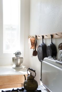 Old fashioned wood and iron peg board in the kitchen.