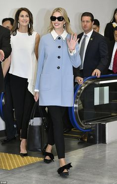 Long journey: Ivanka kept her sunglasses on inside the airport, shielding her eyes after h...