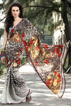 Exclusive Designer Sarees.. Not a huge fan of animal print.. But this looks intense. And she wears it well.