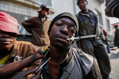 NEEDLE STREET: In downtown Johannesburg, young addicts gather in broad daylight to drift away from society. A man gets injected with the drug nyaope on Goud Street in Johannesburg on 17 May 2016. The street has become a haven for drug dealers and addicts alike. : Moeletsi Mabe, The Times (@moeletsimabe) Read the full story and see all the pictures in @sundaytimesza South Africa, How To Become, African, Instagram Posts, Times, Cityscapes, Pictures, Street, Globe