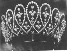 Mary's Boucheron 'Loop' tiara, made by Boucheron in 1902, with diamonds given to Mary by De Beers in 1901. Designed as multiple diamond loops, forming chevrons at the base, with floral motifs within the loops and between the chevrons; with a second base of platinum making it even higher.