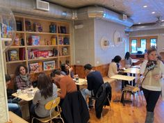 Molly's Cupcakes: Super cute and playful bakery in NYC. Lauren, you should really read this article. Lots of cool conceptual ideas to ponder...Particularly love the built in wall cubbies shown here (we could fill with board games and books for customers).