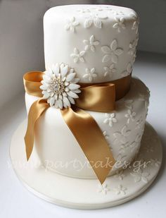 2 tier brooch wedding cake by Party Cakes By Samantha, via Flickr
